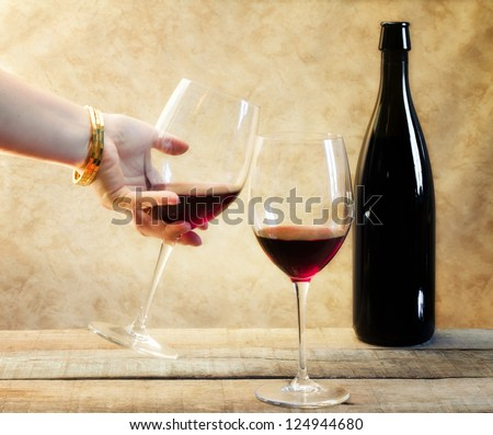 relaxing moment with red wine toasting - stock photo