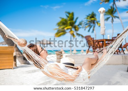 Relaxing on the beach with blue sky.