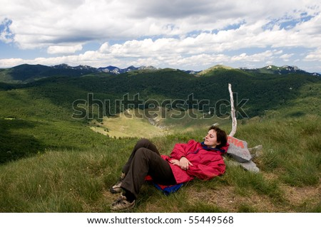 Relaxing on the mountain peek, Far from everyday's troubles - stock photo