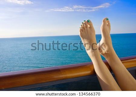 Relaxing onboard a Cruise Ship Balcony - stock photo