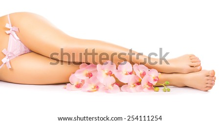 Relaxing pedicure with a pink orchid flower