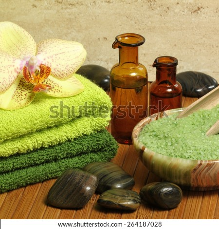 Relaxing spa resort composition -  towels, orchid flower, bottles of essential oil - stock photo