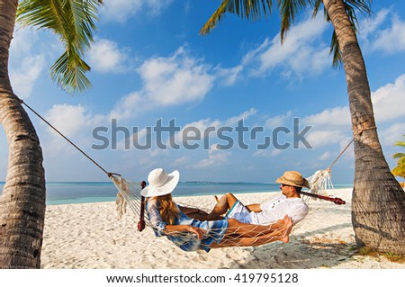 Relaxing time in Kuredu, Maldives on hammock with beach and sea in the background - stock photo