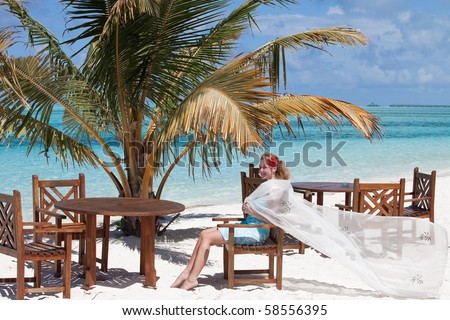 Relaxing under palms - stock photo