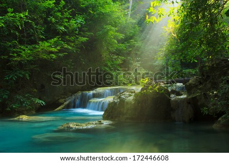 Relaxing view of Erawan waterfall, Erawan National Park, Thailand  - stock photo