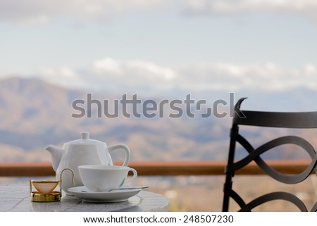Relaxing with a cup of tea and a mountain view - stock photo