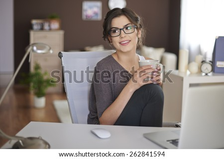 Relaxing with laptop and cup of coffee  - stock photo