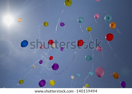 Released flying huge balloons and  blue sky - stock photo