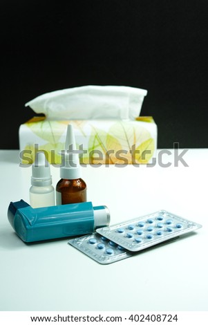 Relief asthma, allergy, flu, fever concept, seasonal allergy, medication and paper tissues - stock photo