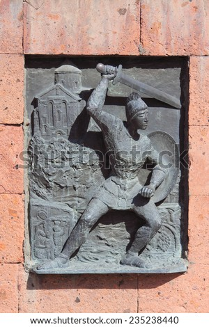 relief picture on building near Etchmiadzin monastery, Armenia. This art object located in public place and the rule of freedom of panorama works in Armenia - stock photo