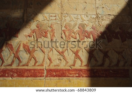 Relief showing a march into Sudan at the Memorial Temple of Hatshepsut. Luxor, Egypt - stock photo