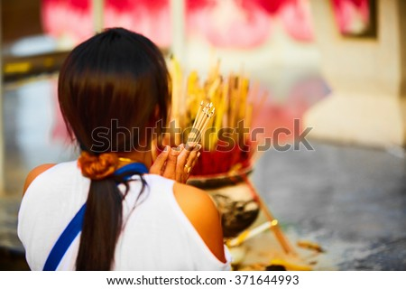 Religion. Close Up Of Young Asian Woman Praying Buddha Holding Burning Incense Aroma Sticks In Hands At Wat Phra Yai, The Big Buddha Temple At Koh Samui, Thailand. Buddhism. Belief And Faith.