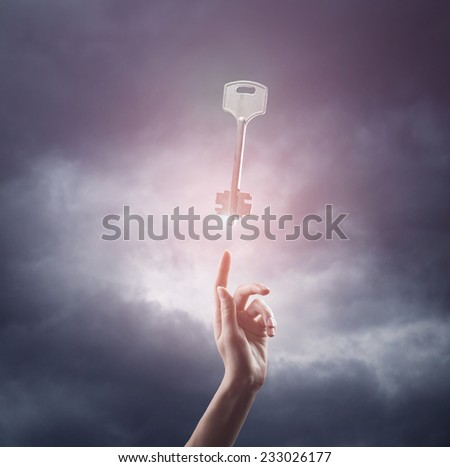 religion concept. finger touching the magic sky with a key