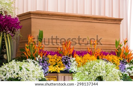 Religion, death and dolor - funeral and cemetery; funeral with coffin with flowers - stock photo