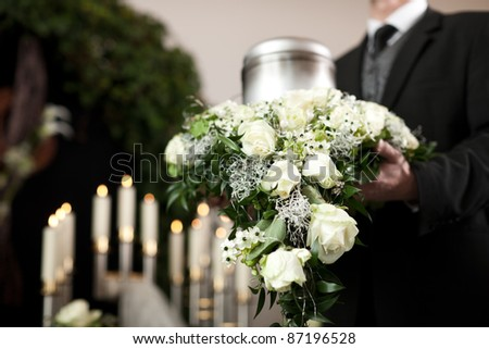 Religion, death and dolor  - funeral and cemetery; urn funeral - stock photo