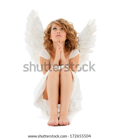 religion, faith, holidays and costumes concept - praying teenage angel girl