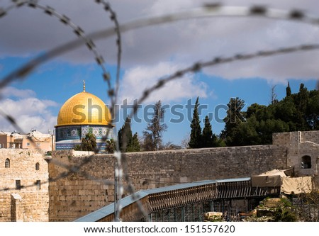 Religion in conflict. Sad reality of the arab - jewish conflicts in Jerusalem. Rock Dome on the Temple Mount in Jerusalem, Israel, behind wired fence. Horizontal view./ Rock Dome behind wired fence - stock photo
