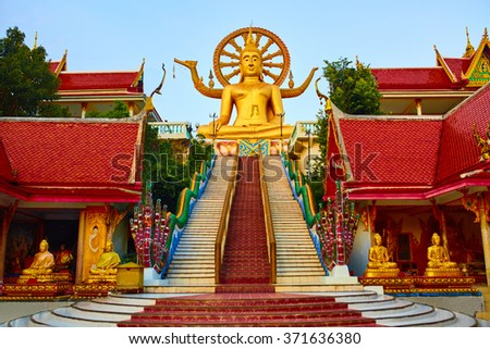 Religion In Thailand. Golden Statue Of Buddha With Dragon Staircase In Wat Phra Yai, The Big Buddha Temple At Koh Samui. Place For Praying, Meditation. Buddhism. Religious Symbol. Travel, Tourism. - stock photo