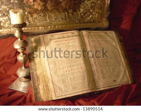 Religion still life with antique Bible, candlestick and candle