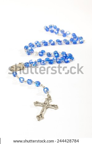 Religion symbol rosary with silver cross isolated - stock photo