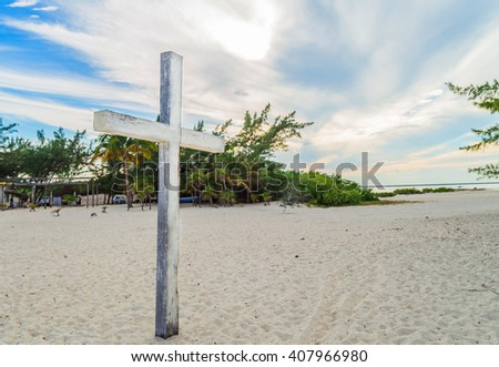 Religious cross on the beach