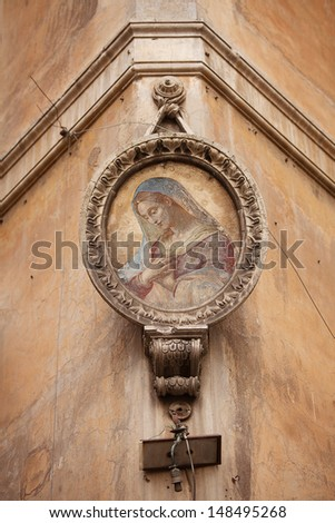 Religious icon mounted on building corner, Campo Marzio, Rome, Italy