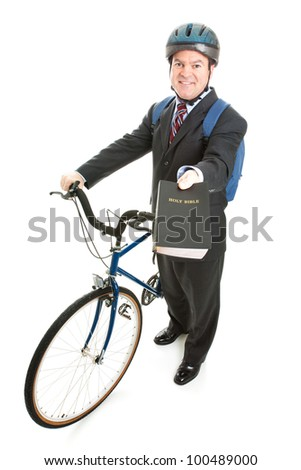 Religious missionary with his bicycle and bible.  Full body isolated on white. - stock photo