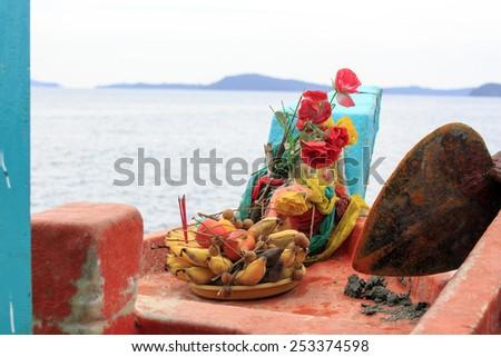 Religious offer of Fresh fruits on thai boat - stock photo