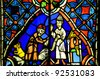 Religious stain glass window in a church. - stock photo