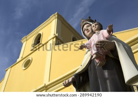 religious statue closeup in front of a church in San Juan del Sur Nicaragua - stock photo