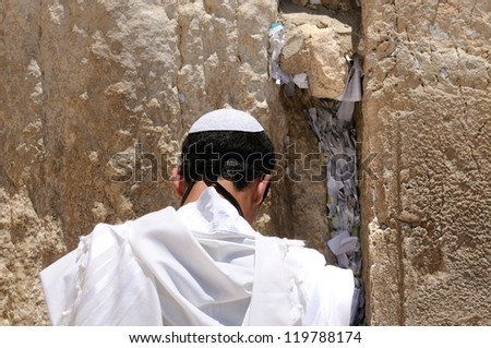 religious Young boy praying in the Western Wall - stock photo