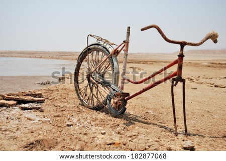 Remains of a bicycle at Dead Sea coast - stock photo