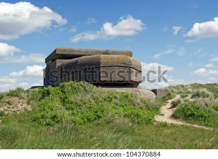 Remains of a Dutch bunker of World War II at IJmuiden, the Netherlands, in the dunes. - stock photo