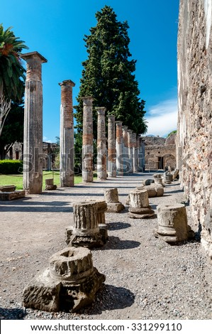 Remains of columns at the house of the faun in Pompeii. Pompeii was destroyed and buried with ash and pumice after Vesuvius eruption in 79 AD. - stock photo