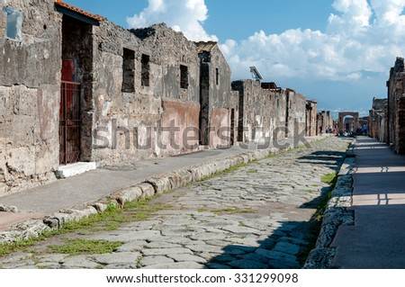 Remains of houses and streets in Pompeii. Pompeii was destroyed and buried with ash and pumice after Vesuvius eruption in 79 AD. - stock photo