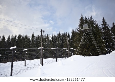 Remains of iron curtain on Czech-German border with watchtower and barbed wire