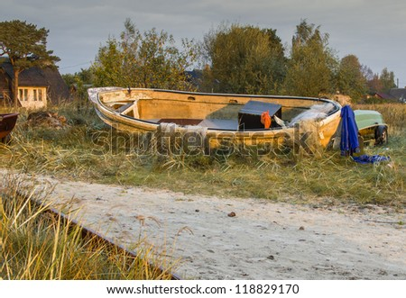 Remains of old fishing boat - stock photo