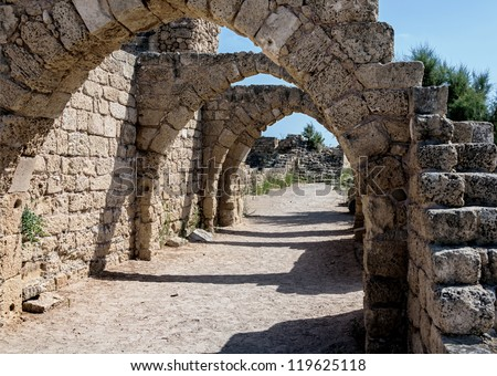 Remains of the arch over the main streets of ruins of the Caesarea, Israel - stock photo