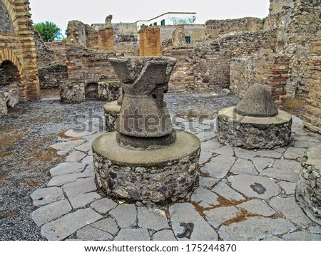 Remains of the bakery at the city of Pompeii, near Naples, Italy, which was destroyed by a volcanic eruption at Mt. Vesuvius in A.D. 79 - stock photo