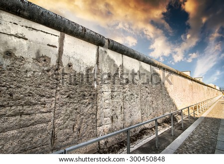 Remains of the Berlin Wall preserved along Bernauer Strasse at sunset - stock photo