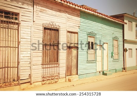Remedios in Cuba - typical old town wooden architecture. Abstract view. Cross processed color tone - retro style filtered image. - stock photo