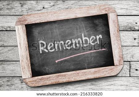 Remember written on chalkboard - stock photo