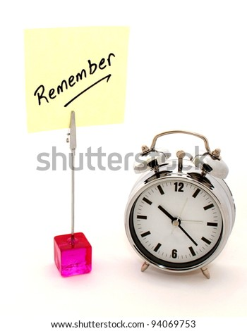 Remember. Yellow note and alarm clock - stock photo