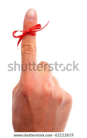 reminder concept with hand and red bow isolated on white background - stock photo