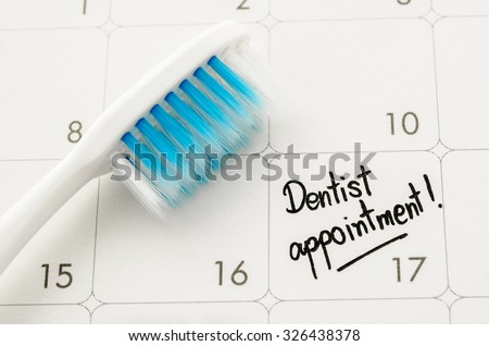 "Reminder ""Dentist appointment"" in calendar with toothbrush. - stock photo"