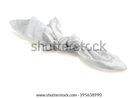 reminder, knot in handkerchief of white cloth, isolated with shadow on a white background, concept for remember and dementia - stock photo