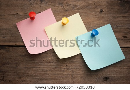 reminder notes on a background of the old wooden logs - stock photo