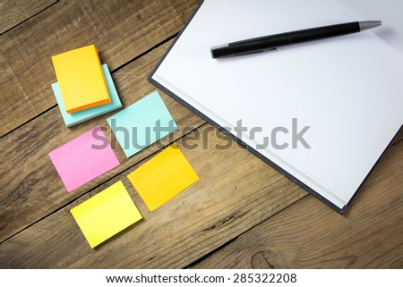 Reminder post it notes on wooden - stock photo