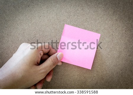 Reminder sticky note on cork board, empty space for text - stock photo