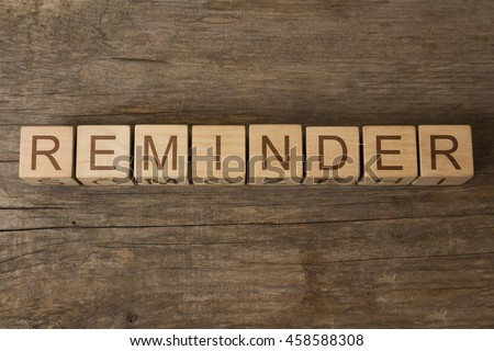 reminder text on wooden cubes - stock photo